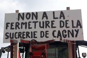 Une pancarte lors d'une manifestation contre la fermeture de l'usine de Cagny